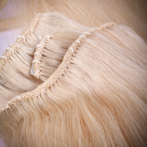 Sewn hair extension weft.